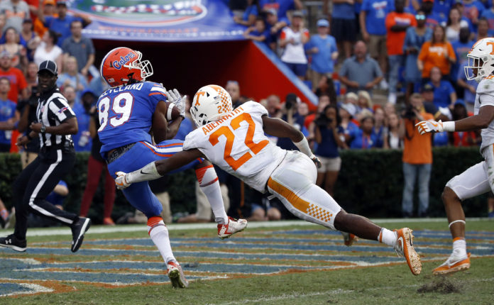 Florida Gators wide receiver Tyrie Cleveland (89) catches the ball for a touchdown as time expires to win the game as Tennessee Volunteers defensive back Micah Abernathy (22) attempted to defend during the second half at Ben Hill Griffin Stadium.