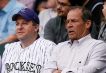 Jared Polis (left) with Rockies owner Dick Monfort at Coors Field in 2019. Credit: Isaiah J. Downing, USA TODAY Sports.