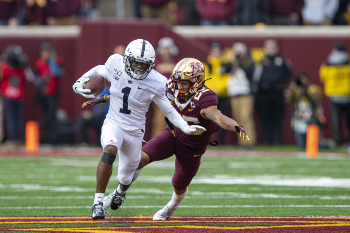Penn State Nittany Lions wide receiver KJ Hamler (1) rushes with the ball after making a catch as Minnesota Golden Gophers defensive back Benjamin St-Juste (25) attempts to make a tackle in the first half at TCF Bank Stadium.
