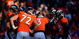 Denver Broncos quarterback Drew Lock (3) huddles with teammates in the second quarter against the Oakland Raiders at Empower Field at Mile High.