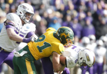 North Dakota State Bison defensive end Derrek Tuszka (91) sacks James Madison Dukes quarterback Ben DiNucci (6) in the fourth quarter at Toyota Stadium.