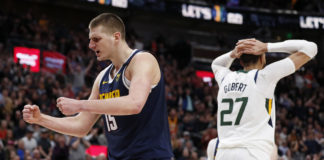Denver Nuggets center Nikola Jokic (15) reacts after a foul against Utah Jazz guard Joe Ingles (2) (not pictured) during the fourth quarter at Vivint Smart Home Arena.