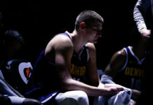 Denver Nuggets center Nikola Jokic (15) sits on the bench in the third quarter against the Golden State Warriors at the Pepsi Center.