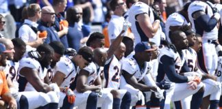 A group of Broncos players kneel for the National Anthem in 2017. Credit: Mark Konezny, USA TODAY Sports.