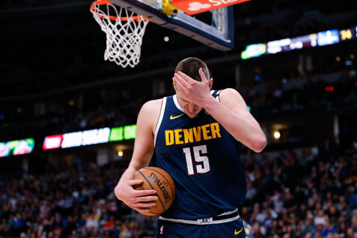 Denver Nuggets center Nikola Jokic (15) reacts after a play in the third quarter against the Golden State Warriors at the Pepsi Center.