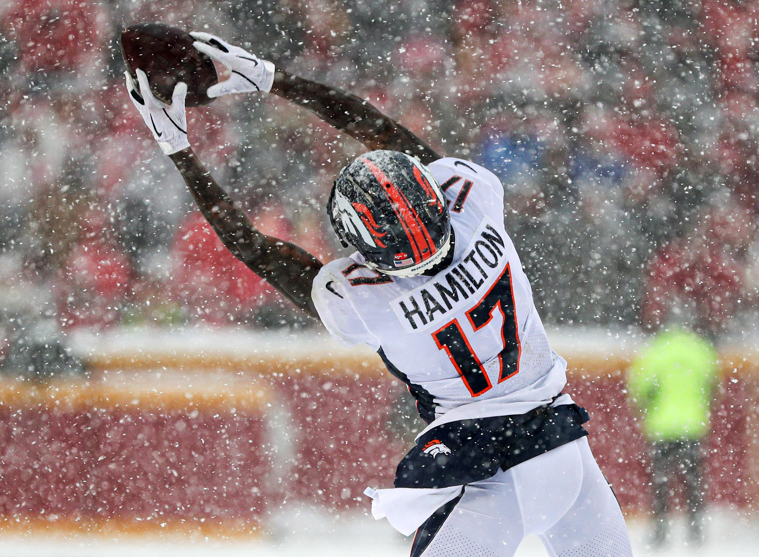 Denver Broncos wide receiver DaeSean Hamilton (17) bobbles the ball during the second half against the Kansas City Chiefs at Arrowhead Stadium.