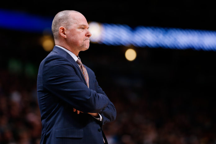 Denver Nuggets head coach Michael Malone looks on in the fourth quarter against the Golden State Warriors at the Pepsi Center.