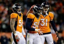 Denver Broncos outside linebacker Von Miller (58) and free safety Justin Simmons (31) and outside linebacker Shane Ray (56) in the fourth quarter against the Oakland Raiders at Sports Authority Field at Mile High.