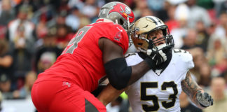 Tampa Bay Buccaneers offensive tackle Demar Dotson (69) blocks New Orleans Saints outside linebacker A.J. Klein (53) during the first half at Raymond James Stadium.