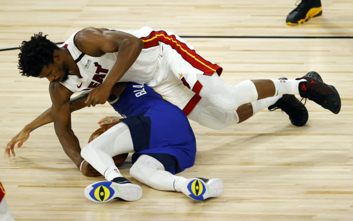 Monte Morris #11 of the Denver Nuggets looses the ball against Jimmy Butler #22 of the Miami Heat at HP Field House at ESPN Wide World Of Sports Complex on August 01, 2020 in Lake Buena Vista, Florida.