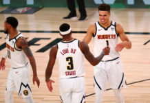 Denver Nuggets forward Michael Porter Jr. (1) and forward Torrey Craig (3) celebrates after defeating the Oklahoma City Thunder in a NBA basketball game at The Arena.