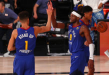 Denver Nuggets forward Michael Porter Jr. (1) and forward Jerami Grant (9) celebrate after defeating the San Antonio Spurs in a NBA basketball game at Visa Athletic Center.
