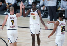 Denver Nuggets' Bol Bol (10) is congratulated by PJ Dozier (35) and Mason Plumlee (7) during the second half of an NBA basketball game Monday, Aug. 10, 2020, in Lake Buena Vista, Fla. at AdventHealth Arena.