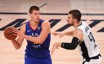 Denver Nuggets center Nikola Jokic (15) is defended by LA Clippers center Ivica Zubac (40) in the third quarter of a NBA basketball game at AdventHealth Arena.