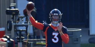 Drew Lock passes at Broncos training camp. Credit: Ron Chenoy, USA TODAY Sports.