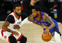 Monte Morris #11 of the Denver Nuggets drives the ball against Norman Powell #24 of the Toronto Raptors during the third quarter at The Field House at ESPN Wide World Of Sports Complex on August 14, 2020 in Lake Buena Vista, Florida.