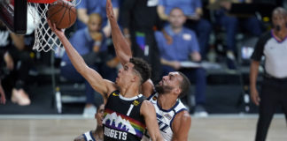 Denver Nuggets' Michael Porter Jr. (1) shoots past Utah Jazz's Rudy Gobert during the second half of an NBA basketball first round playoff game.