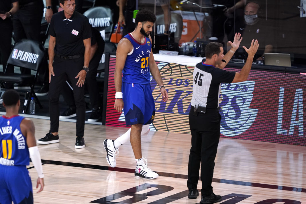 Denver Nuggets' Jamal Murray (27) walks back to the bench following game four of the first round of the 2020 NBA Playoffs at AdventHealth Arena