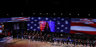 Denver Nuggets and Utah Jazz teams kneel during the National Anthem in game five of the first round of the 2020 NBA Playoffs at ESPN Wide World of Sports Complex.
