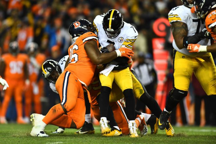 Pittsburgh Steelers quarterback Ben Roethlisberger (7) is sacked by Denver Broncos defensive end Shelby Harris (96) in the fourth quarter at Broncos Stadium at Mile High.