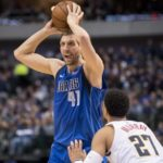 Dallas Mavericks forward Dirk Nowitzki (41) looks to pass the ball over Denver Nuggets guard Jamal Murray (27) during second quarter at the American Airlines Center.
