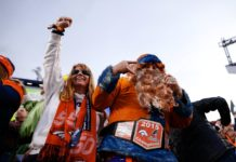 Denver Broncos fans celebrate after a touchdown against the Detroit Lions in the fourth quarter at Empower Field at Mile High.