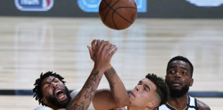 Los Angeles Lakers' Anthony Davis, left, battles Denver Nuggets' Michael Porter Jr. during the first half of an NBA basketball game Monday, Aug. 10, 2020, in Lake Buena Vista, Fla. at AdventHealth Arena.