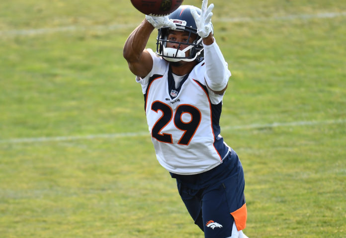 Denver Broncos cornerback Bryce Callahan (29) works out during training camp at the UCHealth Training Center.