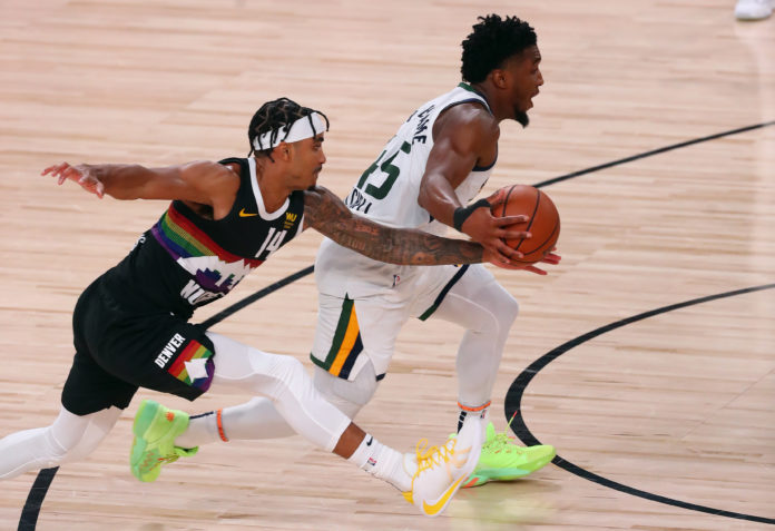Denver Nuggets guard Gary Harris (14) pressures Utah Jazz guard Donovan Mitchell (45) during the second half of game seven of the first round of the 2020 NBA Playoffs at ESPN Wide World of Sports Complex.