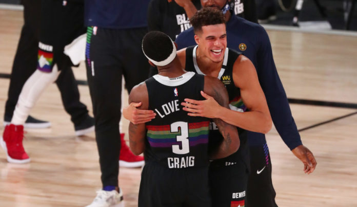 Denver Nuggets forward Torrey Craig (3) celebrates with forward Michael Porter Jr. (1) after defeating the Utah Jazz in game seven of the first round of the 2020 NBA Playoffs at ESPN Wide World of Sports Complex.