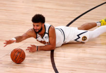 Denver Nuggets guard Jamal Murray (27) reaches for a loose ball during the first half against the LA Clippers in game one of the second round of the 2020 NBA Playoffs at AdventHealth Arena.