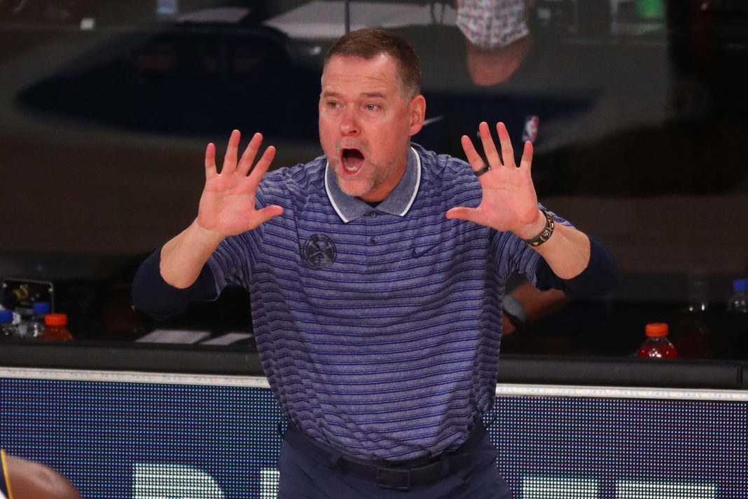 Denver Nuggets head coach Michael Malone reacts during the second half of game two in the second round of the 2020 NBA Playoffs against the LA Clippers at AdventHealth Arena.