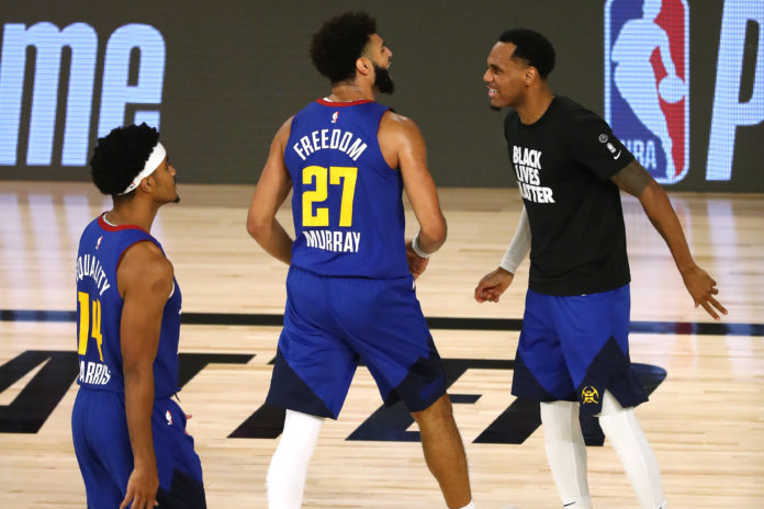 Denver Nuggets guard Jamal Murray (27) celebrates with teammates after making a three point basket against the LA Clippers during the second half of game five in the second round of the 2020 NBA Playoffs at ESPN Wide World of Sports Complex.