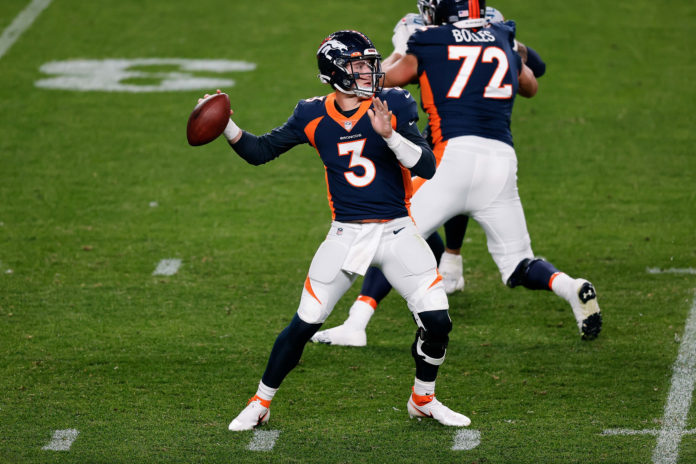 Denver Broncos quarterback Drew Lock (3) attempts a pass in the second quarter against the Tennessee Titans at Empower Field at Mile High.