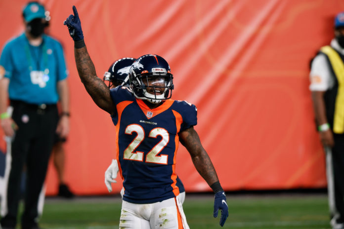 Denver Broncos strong safety Kareem Jackson (22) celebrates after a play in the fourth quarter against the Tennessee Titans at Empower Field at Mile High.