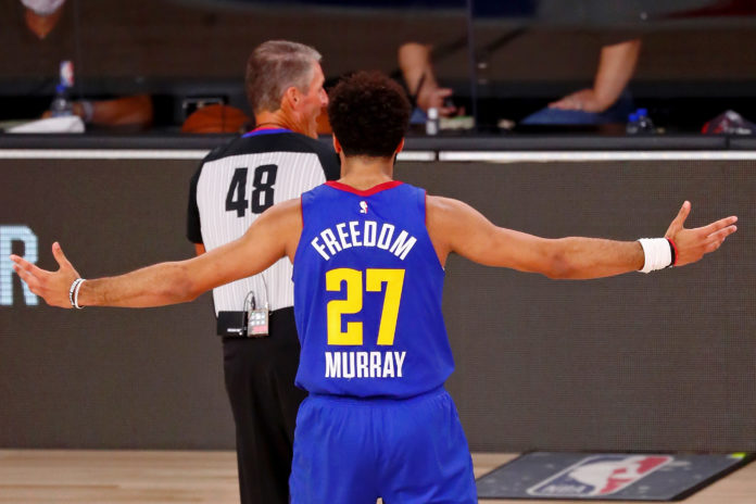 Denver Nuggets guard Jamal Murray (27) reacts after being called for a technical foul against the Los Angeles Lakers during the second quarter in game one of the Western Conference Finals of the 2020 NBA Playoffs at AdventHealth Arena.