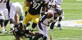 Denver Broncos quarterback Drew Lock (3) escapes the grasp of Pittsburgh Steelers outside linebacker Bud Dupree (48) during the first quarter at Heinz Field.
