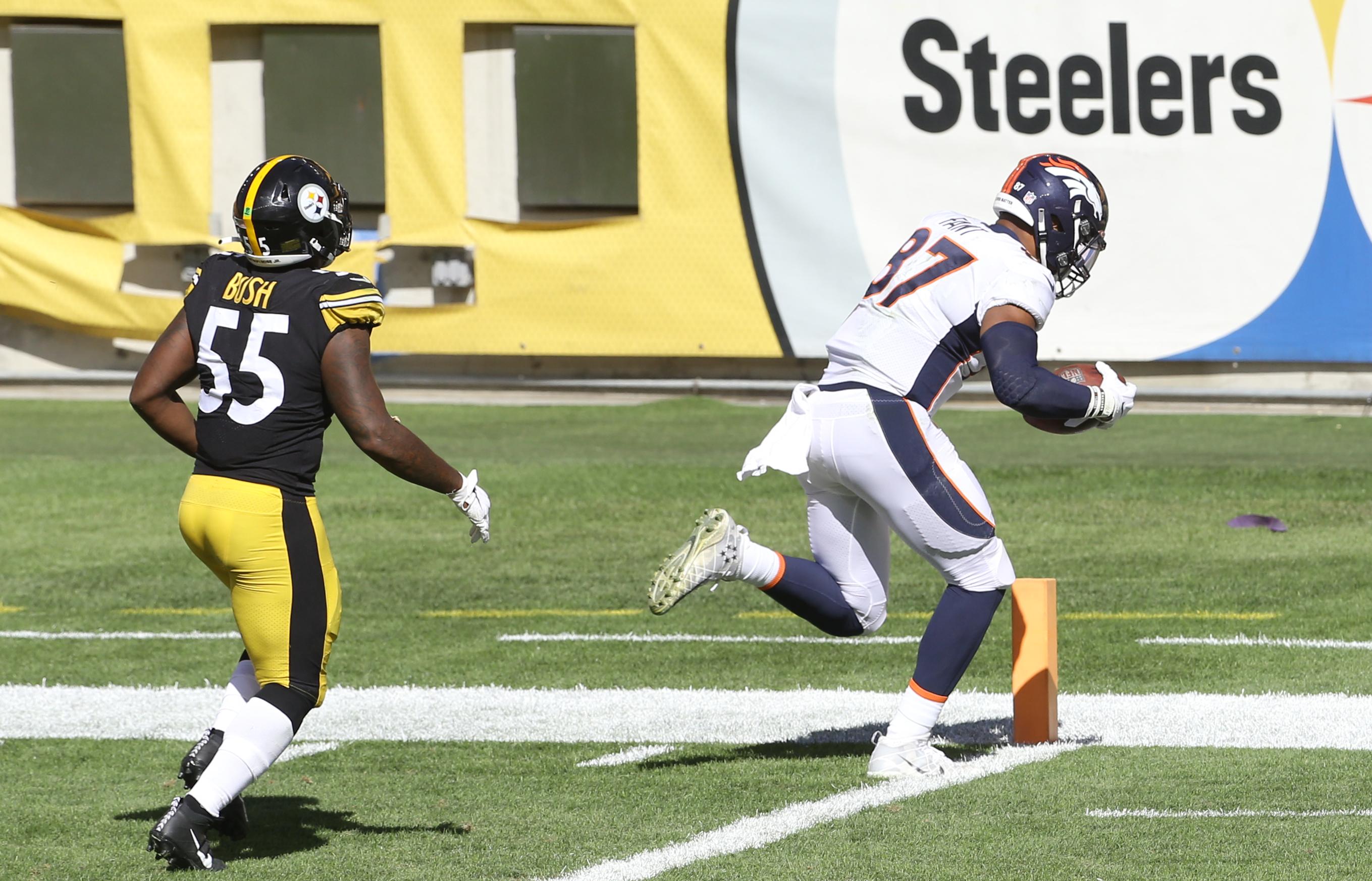 Denver Broncos tight end Noah Fant (87) scores a twenty yard touchdown behind Pittsburgh Steelers linebacker Devin Bush (55) during the third quarter at Heinz Field.