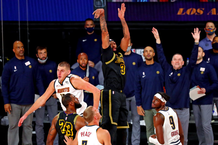 Los Angeles Lakers forward Anthony Davis (3) makes the game winning basket against Denver Nuggets center Nikola Jokic (15) during the fourth quarter in game two of the Western Conference Finals of the 2020 NBA Playoffs at AdventHealth Arena.