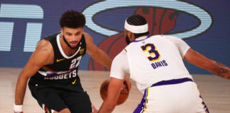 Denver Nuggets guard Jamal Murray (27) dribbles the ball against Los Angeles Lakers forward Anthony Davis (3) during the second half of game three of the Western Conference Finals of the 2020 NBA Playoffs at AdventHealth Arena.
