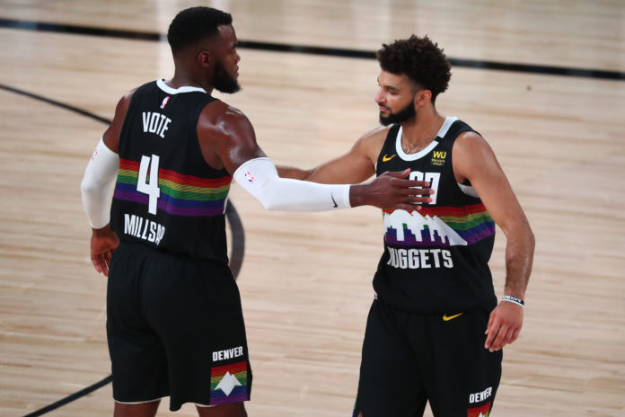 Denver Nuggets forward Paul Millsap (4) and guard Jamal Murray (27) celebrate after defeating the Los Angeles Lakers in game three of the Western Conference Finals of the 2020 NBA Playoffs at AdventHealth Arena.