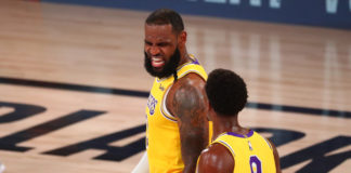 Los Angeles Lakers forward LeBron James (23) walks with guard Rajon Rondo (9) during the second half against the Denver Nuggets in game four of the Western Conference Finals of the 2020 NBA Playoffs at AdventHealth Arena.