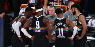 Denver Nuggets head coach Michael Malone talks with his team during a timeout during the second half against the Los Angeles Lakers in game four of the Western Conference Finals of the 2020 NBA Playoffs at AdventHealth Arena.
