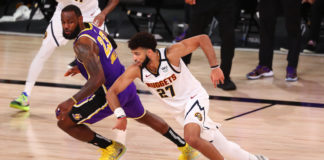 Los Angeles Lakers forward LeBron James (23) chases the ball with Denver Nuggets guard Jamal Murray (27) during the fourth quarter in game five of the Western Conference Finals of the 2020 NBA Playoffs at AdventHealth Arena.