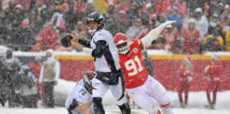 Denver Broncos quarterback Drew Lock (3) throws a pass as Kansas City Chiefs nose tackle Derrick Nnadi (91) attempts the sack during the second half at Arrowhead Stadium.