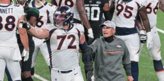 Garett Bolles is held back by Vic Fangio at the end of Broncos - Jets. Credit: Vincent Carchietta, USA TODAY Sports.