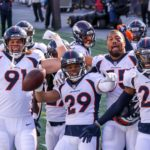 Broncos defense celebrates a turnover against New England. Credit: Paul Rutherford, USA TODAY Sports.