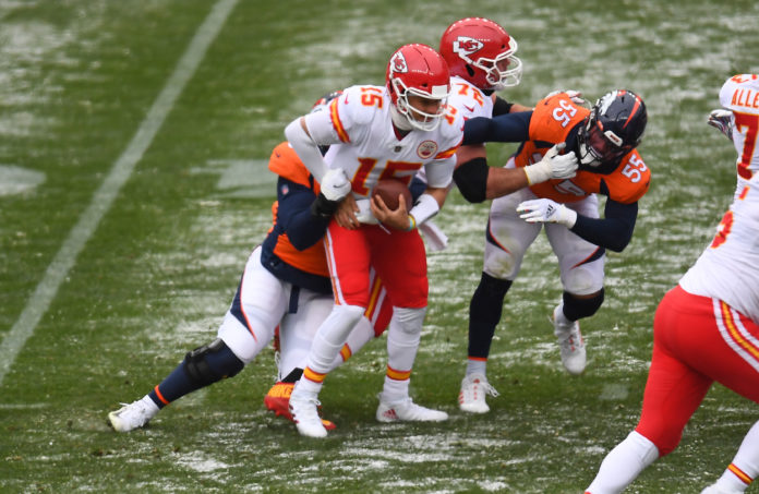 Kansas City Chiefs quarterback Patrick Mahomes (15) is sacked by Denver Broncos defensive end Dre'Mont Jones (93) in the first half at Empower Field at Mile High.