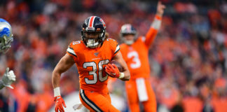 Denver Broncos running back Phillip Lindsay (30) carries the ball in the fourth quarter against the Detroit Lions at Empower Field at Mile High.