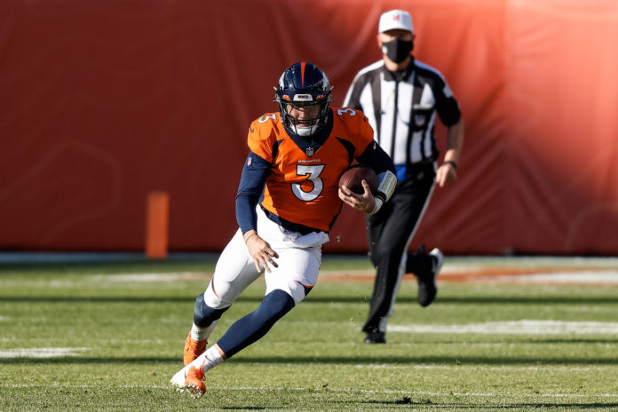 Denver Broncos quarterback Drew Lock (3) runs the ball in the first quarter against the Los Angeles Chargers at Empower Field at Mile High.